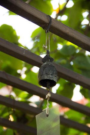 Tradition buddhist wishing bells on a tree in Thailand