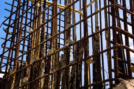 View on rusty square reinforcement for concrete