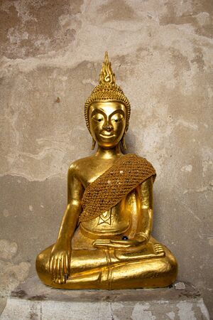 Golden Buddha in a temple Thailand