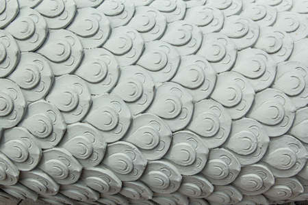 Naga stucco sculpture on the side, the scales are arranged horizontally