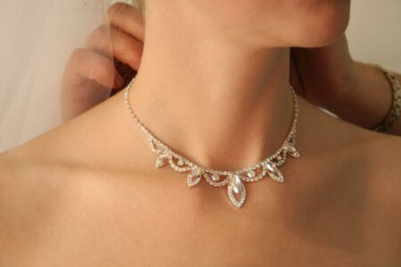 Necklace on a neck at the bride. photo