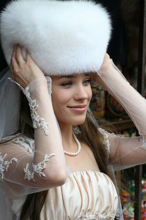 The bride in a fur Hat photo