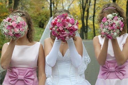 Three Bridal wedding bouquets of flowers