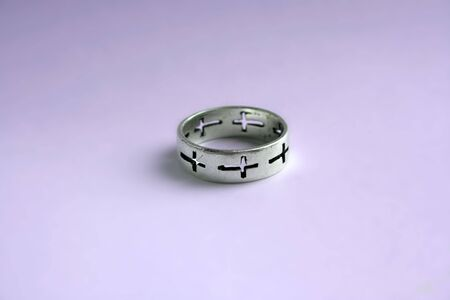 Silver ring with crosses photo
