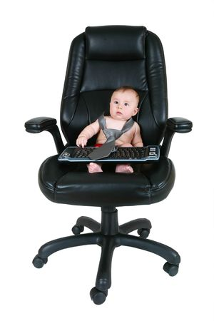Baby businessman looks at keyboard Stock Photo