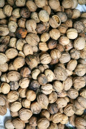 Brown walnuts background photo