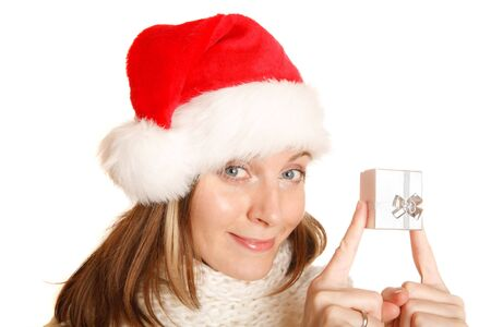 Portrait of a beautiful Santa girl with a gift box photo