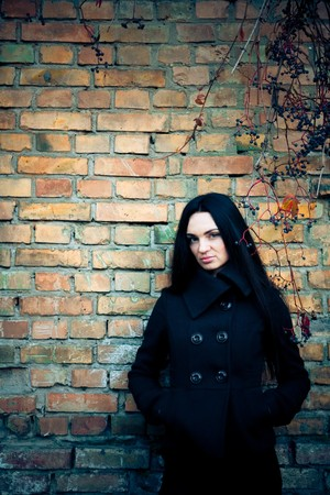 attractive brunette woman with grunge wall Stock Photo - 3988892