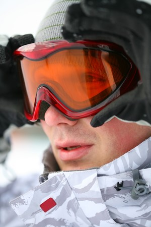Portrait of snowboarder looking at camera through eyeglasses Stock Photo - 4390953