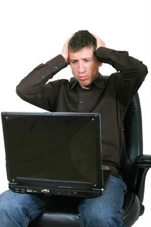 holding the head: Businessman with laptop, holding head in hands