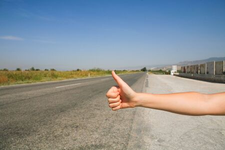 hitchhiking: hitchhiking the road Stock Photo
