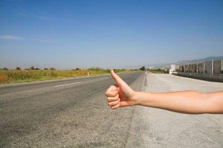 hitchhiking the road Фото со стока