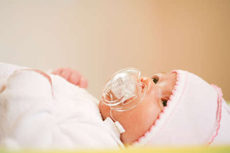 adorable baby with pacifier photo