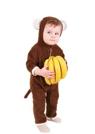 Baby in monkey costume with bananas Stock Photo