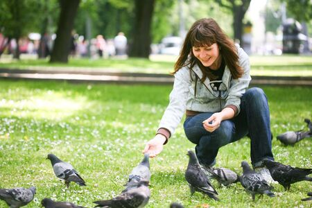 Girl with doves in park photo