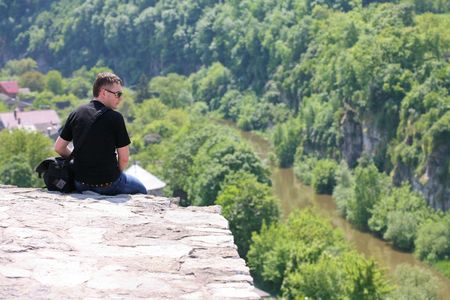 Sitting alone at the top of the precipice photo