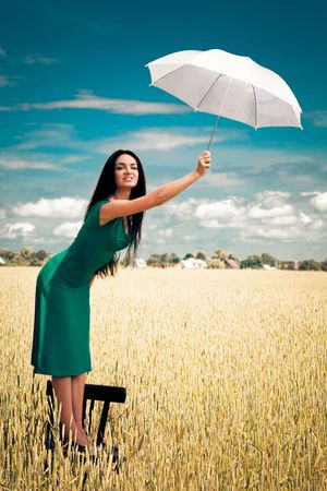 gorgeus: girl with an umbrella in the field