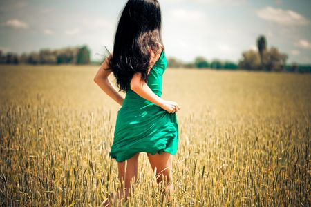 woman running in yellow field photo