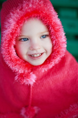 Portrait of a smiling little girl photo