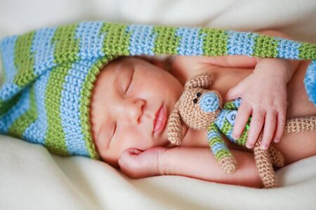 adorable newborn baby with teddy Stock Photo