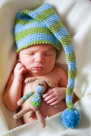 nappy: adorable newborn baby with teddy Stock Photo