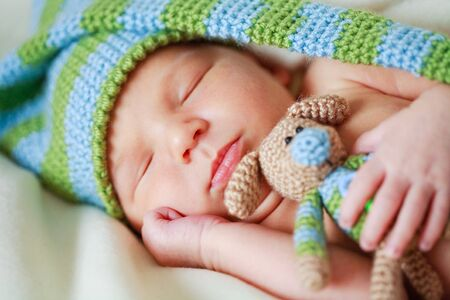 surprised kid: adorable newborn baby with teddy Stock Photo