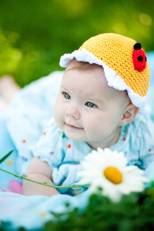 Adorable baby girl outdoors in the grass