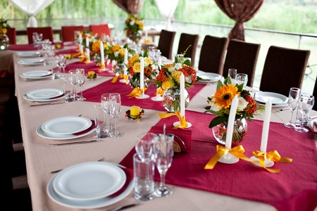 catering service: Wedding flowers - tables set for wedding Stock Photo