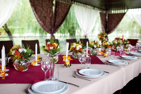 outdoor event: Wedding flowers - tables set for wedding Stock Photo