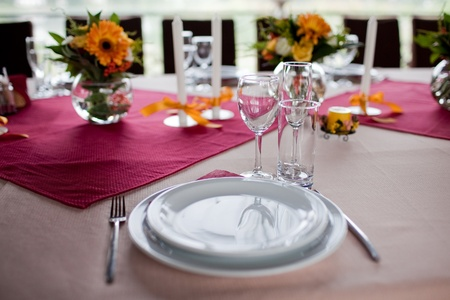 on the tablecloth:  tables set for wedding Stock Photo