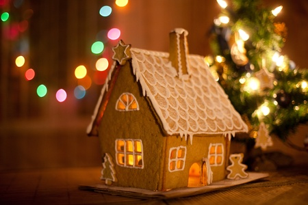home baked: Gingerbread house with lights inside Stock Photo