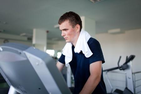 Healthy man a treadmill in a sport center photo