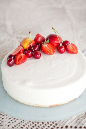 White Cream Icing Cake with Fruits photo