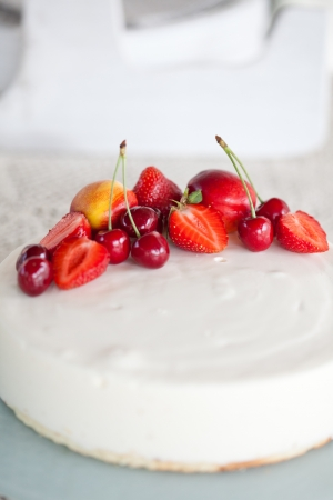 White Cream Icing Cake with red Fruits photo