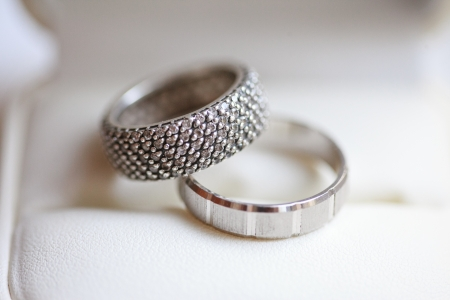 Beautiful wedding rings on the table photo