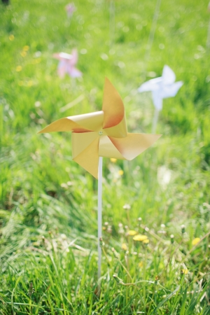 paper windmill in green grass field