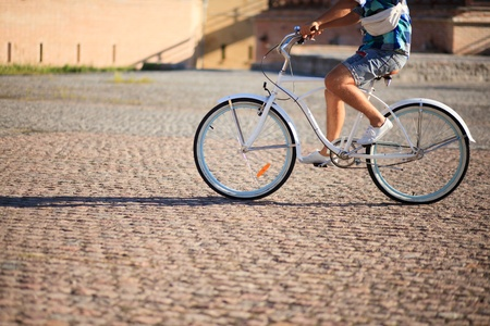 man riding on vintage bicycle by road Stock Photo - 15802195