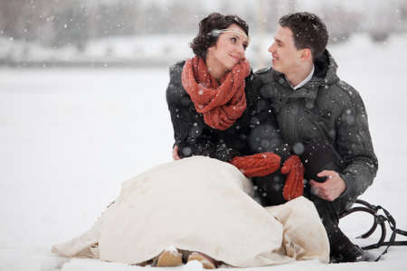 Happy bride and groom in winter day photo