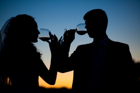 Bride and groom drink wine at sunset Stock Photo - 16012628