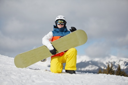 against the sun: female snowboarder against sun and blue sky