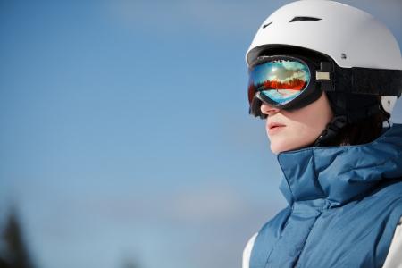 against the sun: female snowboarder against sun and sky