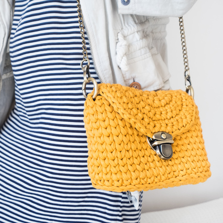 Close up photo of woman bag with fashionable woman