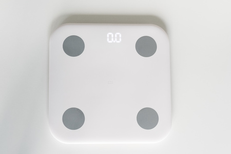Kitchen scale over white background