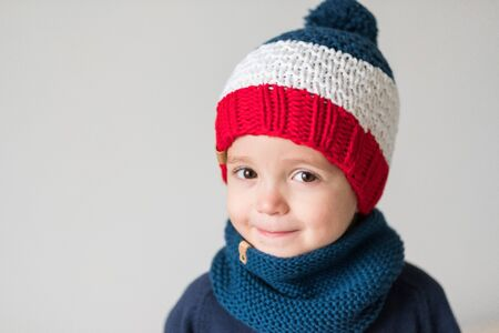 funny cute kid in knitted hat Stock Photo