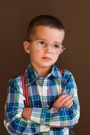 Portrait of smart stylish little boy