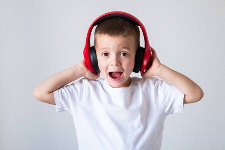 Young boy listening to music on headphones