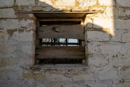 Boarded up window on an old building