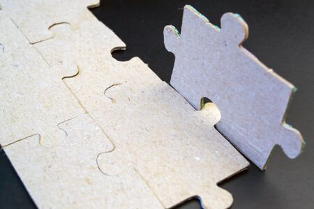 Large brown puzzles on a black background
