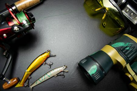 Fishing tackle on a black background Banque d'images