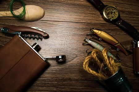 Fishing tackle on a wooden background